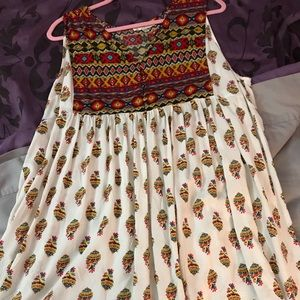 Native print sleeveless tunic top